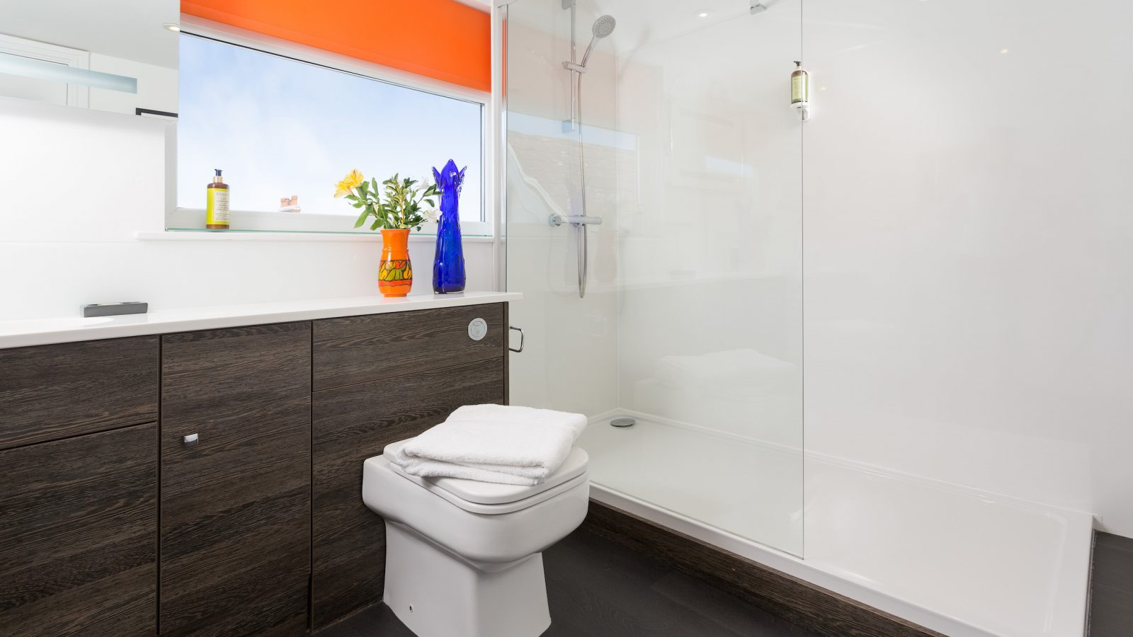 Large walk in shower room with storage
