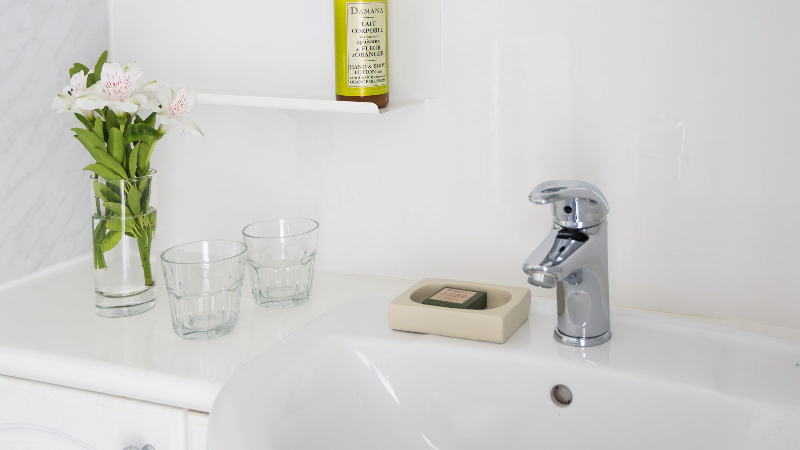 Bathroom mirror with lighting, charging point and demister